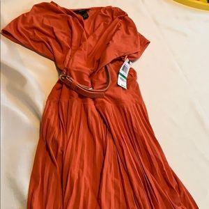 Orange belted pleated skirt dress